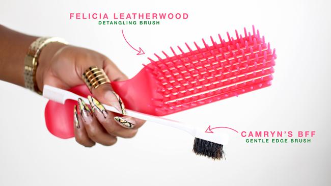 Yolanda's manicured hands holding a detangling brush and edege brush