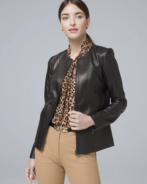 A woman wearing a leather jacket